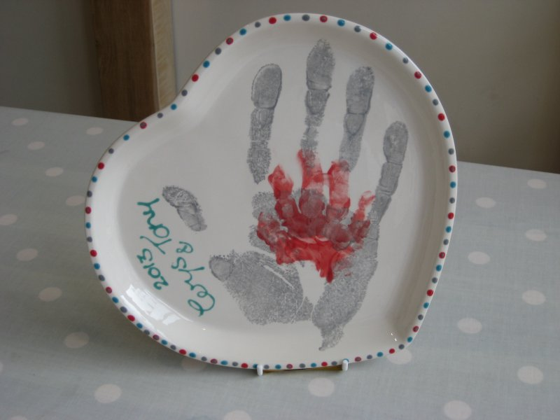 Grandad and Cerys' handprints